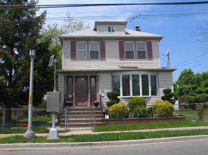 Front of the house VERY updated- lots of trees and shrubbery are no longer there- all windows have been replaced, bay window added to the front parlor (there were tall individual windows all around that room, replaced by one bay)